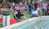 Genevieve Turner Razim placing of flowers in the Reflection Pool