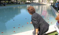 Debra M. Klinger, Human Resources Administrator, placing a flower in the Reflection Pool