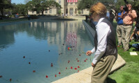 Canon placing flower in the Reflection Pool