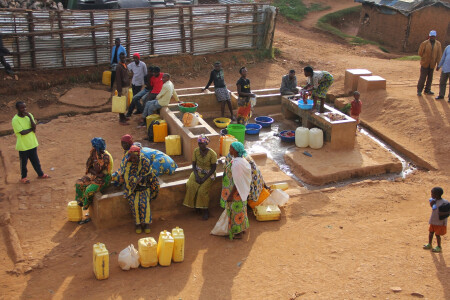 Congolese refugees at Gihembe Camp in Rwanda gather for wash day.